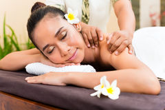 Indonesian Asian woman in wellness beauty day spa. Indonesian Asian women in wellness beauty day spa having aroma therapy massage with essential oil, looking Royalty Free Stock Photos