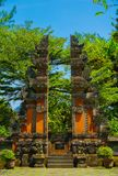 Indonesian bali gate with red brick style and green tree on background - photo indonesia royalty free stock photo