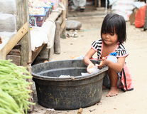 Indonesian barefoot child working royalty free stock images