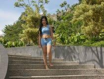 Indonesian Beautiful girl play in garden Stock Photos