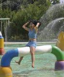 Indonesian Beautiful girl play water I Royalty Free Stock Image