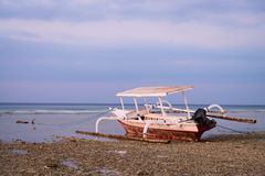Indonesian boat on beach at low tide Stock Photography