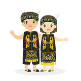 Kids in Dayak Traditional Dress Cartoon Vector. Indonesian boy and girl wearing Dayak traditional dress and holding hand, cartoon illustration vector illustration