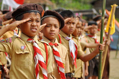 Indonesian Boy Scouts. Boy Scouts Saluting National Flag in Scout Ceremony at West Lampung, Sumatra stock photography