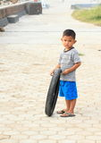 Indonesian boy with tire Stock Image