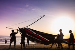 Indonesian boys going to fly a kite. Near the coast on the background of clear sky. During the Indonesian holidays, there are competitions of flying kite, this Royalty Free Stock Image