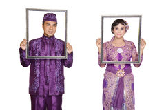 Indonesian bridal couples. Were dressed in kebaya costume Royalty Free Stock Photos