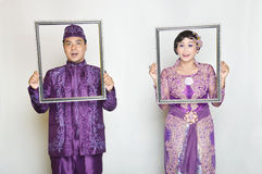 Indonesian bridal couples. Were dressed in kebaya costume Royalty Free Stock Photography
