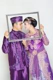 Indonesian bridal couples. Were dressed in kebaya costume Royalty Free Stock Photo