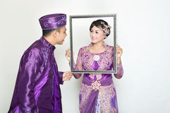 Indonesian bridal couples Royalty Free Stock Photo