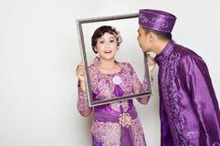 Indonesian bridal couples. Were dressed in kebaya costume Stock Image
