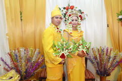 Indonesian bridal couples. Were dressed in traditional red banjarnese costume Royalty Free Stock Images