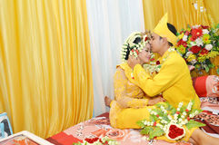 Indonesian bridal couples. Were dressed in traditional red banjarnese costume Royalty Free Stock Photography