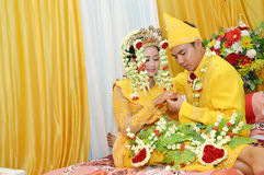 Indonesian bridal couples. Were dressed in traditional red banjarnese costume Royalty Free Stock Photo