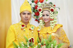 Indonesian bridal couples. Were dressed in traditional red banjarnese costume Stock Photo