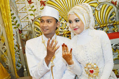 Indonesian bridal couples Stock Photos
