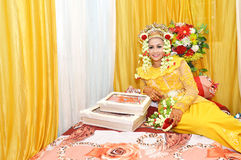 Indonesian bridal. Were dressed in traditional red banjarnese costume Royalty Free Stock Photos