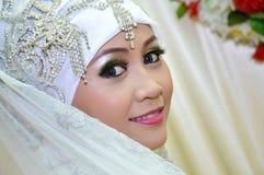 Indonesian bride. Beautiful Indonesian bride dressed in traditional white kebaya Stock Image