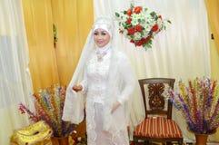 Indonesian bride. Beautiful Indonesian bride dressed in traditional white kebaya Stock Images