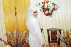 Indonesian bride. Beautiful Indonesian bride dressed in traditional white kebaya Royalty Free Stock Photography