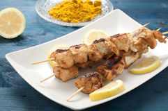 Indonesian chicken satay skewers with curry , peanut butter Royalty Free Stock Images