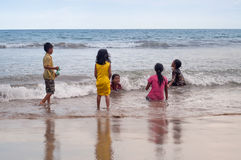 Indonesian children swim in the sea on Tiku beach Stock Photos