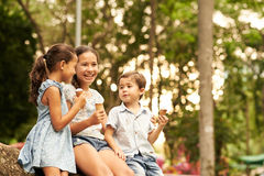 Indonesian children. Talking and eating ice-cream in the park Royalty Free Stock Photos