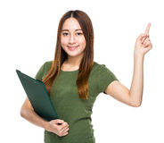 Indonesian Chinese mixed woman with clipboard and finger up Stock Images