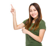 Indonesian Chinese mixed woman with two finger point up Royalty Free Stock Images