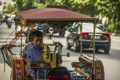Indonesian coachman boy. Coachman boy in Indonesia, Bogor Royalty Free Stock Image