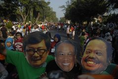 INDONESIAN CORRUPTION WAR CONTROVERSY. Men wears mask of corrupt convicted politicians on a rally in Solo, Java, Indonesia. Controversies clouded Indonesian anti Royalty Free Stock Image
