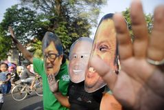 INDONESIAN CORRUPTION WAR CONTROVERSY. Men wears mask of corrupt convicted politicians on a rally in Solo, Java, Indonesia. Controversies clouded Indonesian anti Stock Photo