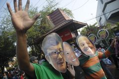 INDONESIAN CORRUPTION WAR CONTROVERSY. Men wears mask of corrupt convicted politicians on a rally in Solo, Java, Indonesia. Controversies clouded Indonesian anti Stock Image