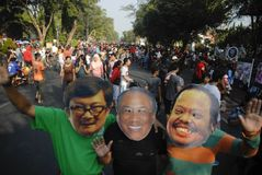INDONESIAN CORRUPTION WAR CONTROVERSY. Men wears mask of corrupt convicted politicians on a rally in Solo, Java, Indonesia. Controversies clouded Indonesian anti Royalty Free Stock Photo