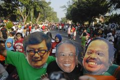 INDONESIAN CORRUPTION WAR CONTROVERSY. Men wears mask of corrupt convicted politicians on a rally in Solo, Java, Indonesia. Controversies clouded Indonesian anti Royalty Free Stock Photography