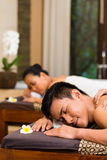 Indonesian couple having wellness massage Royalty Free Stock Image