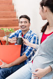 Indonesian couple taking coffee break during relocation Royalty Free Stock Photo