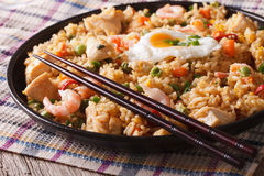 Indonesian cuisine: nasi goreng with chicken, shrimp and vegetab Stock Images