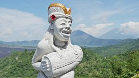 Indonesian Culture Religion Statue Volcano Sunny 4k. 4k footage of a typical Indonesia statue related with the culture and religion, with volcanos in the stock video