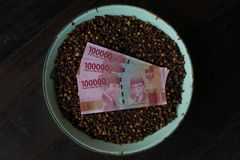 Indonesian Currency with clove royalty free stock photography