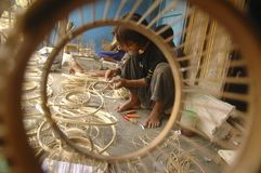 INDONESIAN DECLINING ECONOMY. A bamboo handicraft workshop in Solo, Java, Indonesia. In 2013, Indonesian economy grew 5.8 percent (Year over year), declining Royalty Free Stock Photos