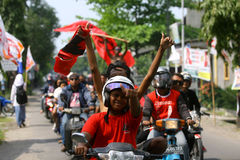 Indonesian democracy struggle party campaign. Supporters waving flags of Indonesian democracy struggle party during the campaign in Surakarta, Indonesia stock image