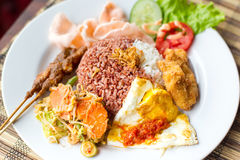 Indonesian dish with chicken satay Royalty Free Stock Image
