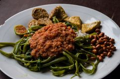 Indonesian dish kankung plecing spicy water spinach dish typical for Lombok island close up shot.  royalty free stock photos