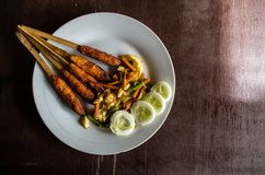 Indonesian dish Lombok: Sate Pusut marinated meat mix on stick copy space right Stock Photos