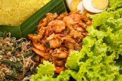 Indonesian dish oseng tempe udang on nasi tumpeng. Close up portrait of indonesian dish oseng tempe udang on nasi tumpeng stock photo