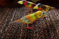 Indonesian ethnic art - painted wooden birds stock image