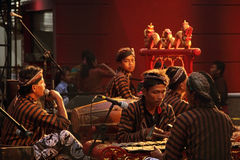 Indonesian ethnic musicians playing Gamelan instruments Royalty Free Stock Images