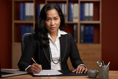 Indonesian female lawyer. Portrait of Indonesian female lawyer at her workplace Royalty Free Stock Photo
