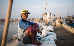 Indonesian fisherman chilling prior to work Royalty Free Stock Photo